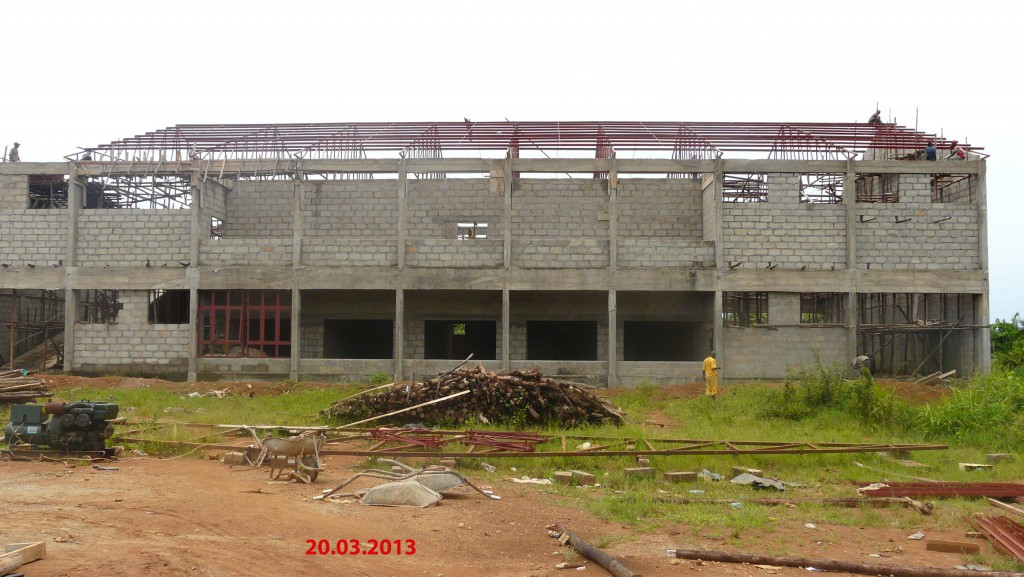Site view 20th March 2013. Note workers doing final touches to roof steel structure